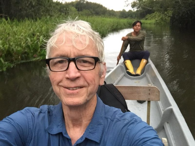 Lang in canoe with Eddie in background